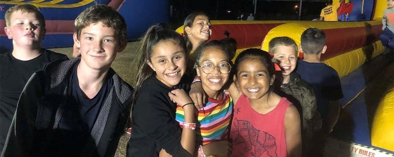 Students enjoying bounce houses at TK Carnival