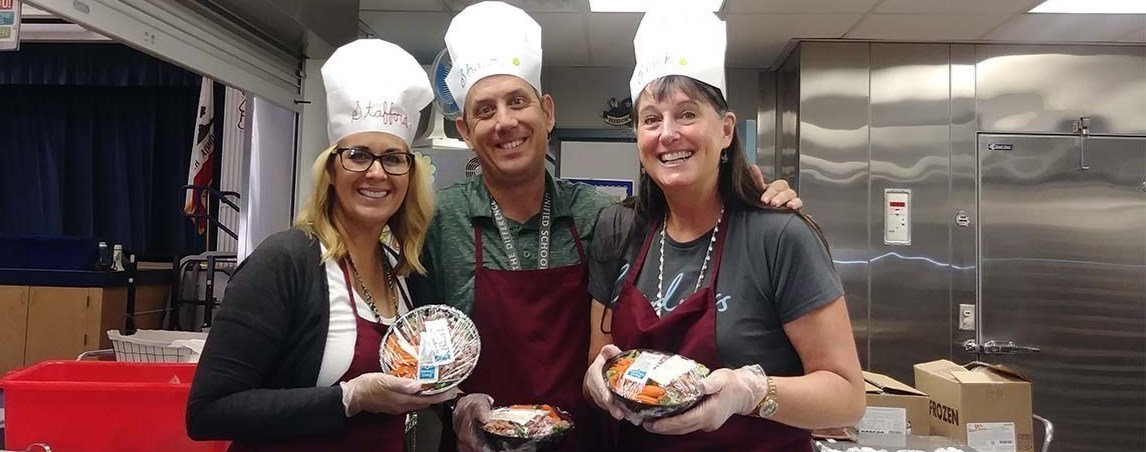 Teachers helping in the cafeteria