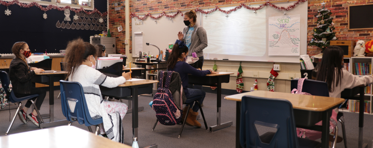 In-Person Teacher Instructing Students